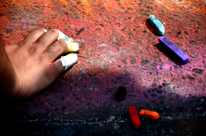 Close up shot of one of the chalk artist's hands during the Larimer Square Chalk Art Festival