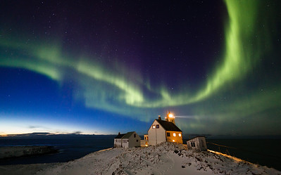 Aurora borealis over Hornøya lighthouse. Hornøya is the easternmost point in Norway.