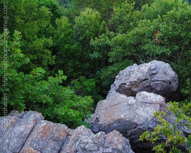 Balanced Rock, an outcrop of Arkansas novaculite boulders, set in lush forest.