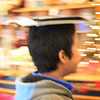 12-12-14: sometimes a kid just walks by, with a book on his head. Why I love my library, reason #223