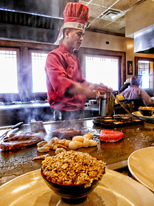 Enjoying lunch at a local Japenese place, and watching the most talented cook.  He put on a great show, and the bowl of fried rice in the foreground was yummy!  Have a wonderful day!!  Linda