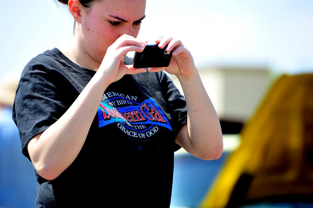4/2/11  At today's car show, there were many, many people taking photos of all the great cars.  I liked this girl's shirt.  She was really sweet.  See the heavily processed shot here:  http://lgood.smugmug.com/Other/Daily-Photos-2010/12484643_ezMcC#1237371852_g5f4D