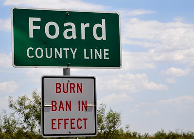 Hot and Dry in Foard County Texas.  Taken during the summer of 2011 in the far western part of Texas, and it was indeed hot and dry.  The exterior temperature as shown by the car was 111 degrees.  A burn ban has probably be in effect there for a long time given the extreme drought of this summer.