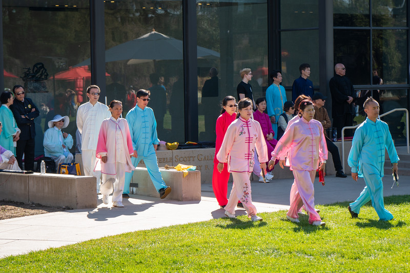 Washu tai chi performers take the field in front of the Scott Galleries at the Huntington Library and Botanical Gardens