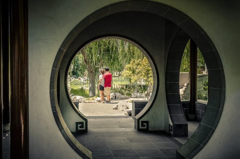 Couple contemplating the lake in the Chinese Garden at the Huntington