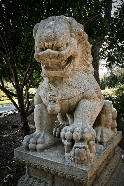 Female guardian lion with paw on cub, entrance to Chinese Garden at the Huntington