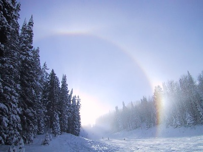 "A ""Sun Dog"" - - refraction of the sun's light by ice crystals in the air.  Taken in Dec 07 at Deer Valley, Utah. Brett Dula"