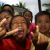 INDONESIAN KIDS AT CREMATION SIANGAN. BALI.