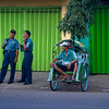 MALANG. STREET LIFE. POLICE MEN AND RIKSJA. JAVA. INDONESIA.