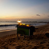 JIMBARAN. BALI. CORN SELLER AT JIMBARAN BAY DURING SUNSET.