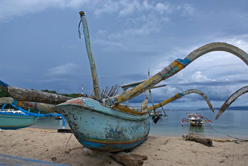 BOAT ON THE BEACH OF PADANG BAI. BALI. INDONESIA.