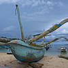 BOAT ON THE BEACH OF PADANG BAI. BALI. INDONESIA.