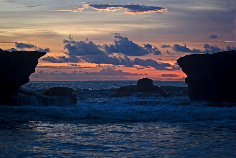SUNSET AT PURA TANAH LOT. BALI. INDONESIA.