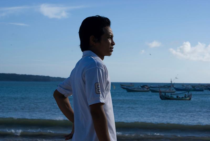 BALI. JIMBARAN BAY. BALINESE GUY DEDIK ON THE BEACH.