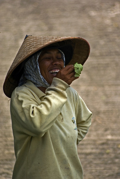 BALINESE WOMAN IS LAUGHING.