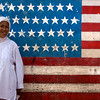 BOGOR. JAVA. THIS IS NOT AMERICA. <br /> MUSLIMA IN FRONT OF AN AMERICAN FLAG. KAMPUNG.