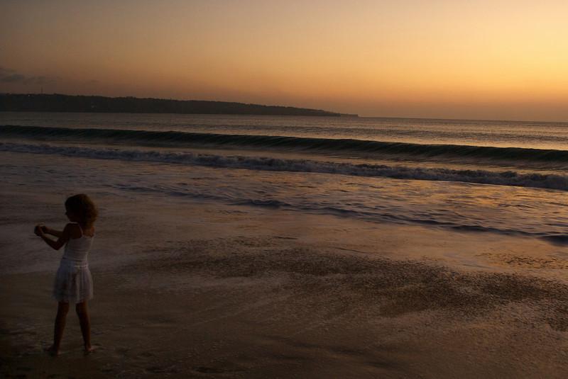 SUNSET ON THE BEACH OF JIMBARAN. JIMBARAN BAY.  BALI.