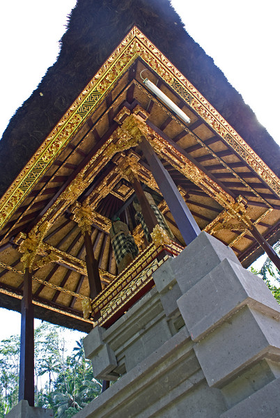 BALI. GUNUNG KAWI. SHRINE WITH GOLD PAINTED ROOF.