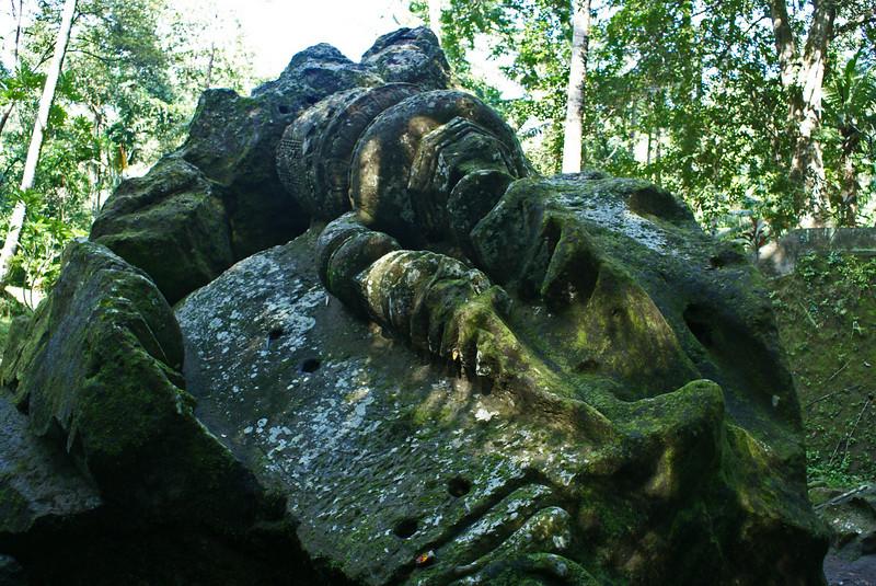BALI. PIECE OF A BROKEN BUDDHA STATUE. ELEPHANT CAVE.