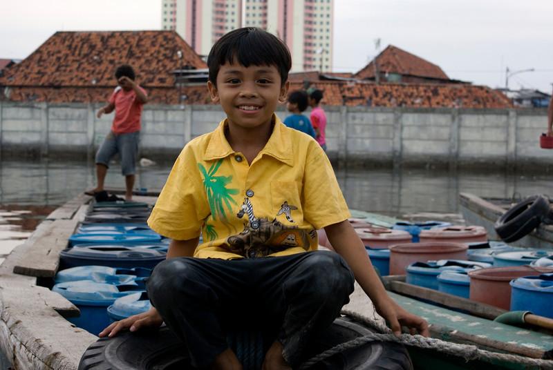 JAVA BOY IN HARBOR OF JAKARTA.