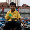 JAVA BOY IN HARBOR OF JAKARTA.