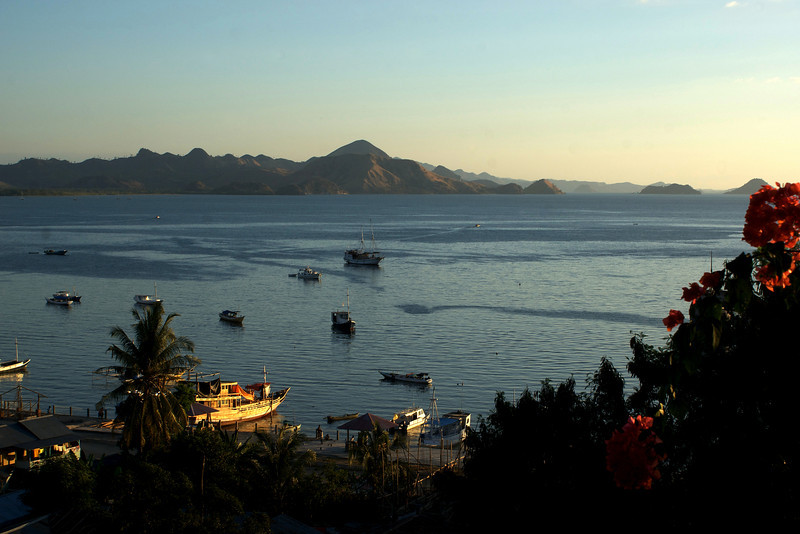 SUNRISE AT THE BAY OF LABUHAN BAJO. FLORES. NUSA TENGGARA (A.K.A. LESSER SUNDA ISLANDS). INDONESIA.