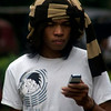 BALI. BALINESE BOY USING HIS NOKIA CELL PHONE.