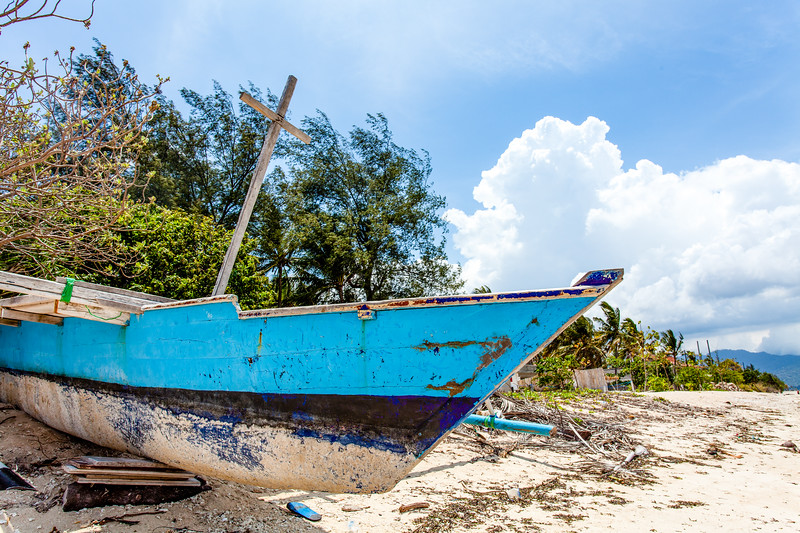 Blue and white fishing boat on the beach of Gili Air, Indonesia, Southeast Asia