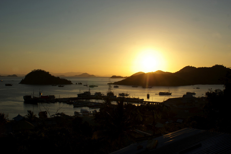 SUNSET OVER THE BAY OF LABUHAN BAJO. FLORES. NUSA TENGGARA (A.K.A. LESSER SUNDA ISLANDS). INDONESIA.