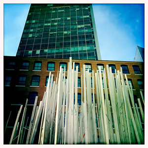 Public art installation with Atlantic Wharf tower rising in background.