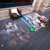 ROME. STREET ARTIST PAINTS ANGELS ON THE STREET.