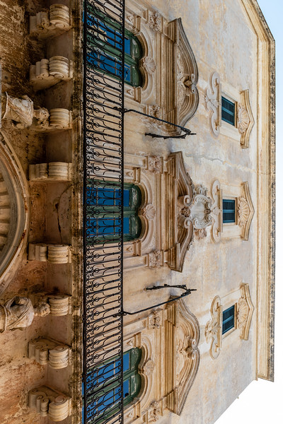 Facade of an old city palace in the old town of Gallipoli, Apulia, Italy
