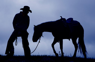 Cowboy and Horse Silhouette with blue sky
