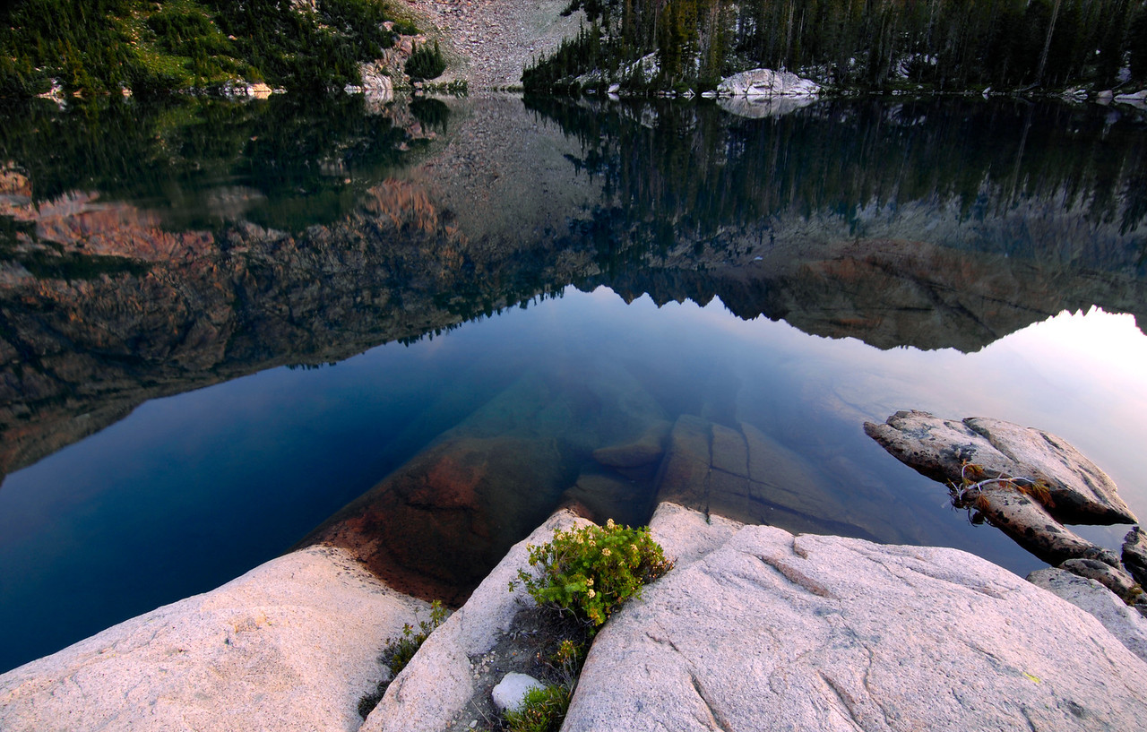 Sawtooth Calm - Idaho<br /> <br /> Granite shores submerged by silent cold waters, near the shore of an unnamed lake in the Sawtooth Mountains of Idaho.