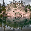 Rock Face, Sawtooth Mountains - Idaho<br /> <br /> The reflection of this pink granite dome presents various illusions of shapes and faces.  The Sawtooths offer up hundreds of lakes such as this, each with its own interpretation and sense of beauty.