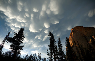 Storm over the Sawtooth Mountains - Idaho  Here, a swift blanket of mammatus clouds forms over the summit of the steep granite walls of the Elephants Perch, in the Sawtooth Mountains of Idaho. Shortly after this image was captured, there was two inches of marble-sized hail covering the ground.
