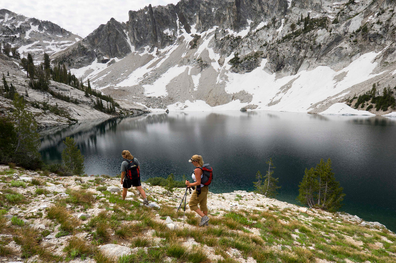 Scenic Lake, Sawtooth Mountains - Idaho<br /> <br /> Adventuresome hikers trek past the cold waters of Scenic Lake, deep in the heart of the Sawtooth Mountains of Idaho. Their goal - to finish a 22 mile day hike in under 13 hours.