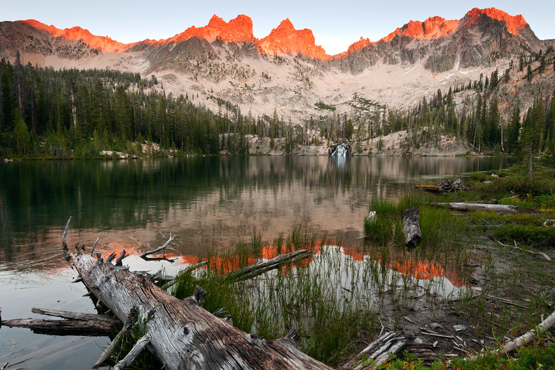 Ring of Fire, Sawtooth Mountains - Idaho<br /> <br /> Cramer Lake, with the ring of granite teeth glowing in the altered hues of a distant forest fire. Prominent on the center of the ridge is: the Coffin, the Birthday Cake, Mt. Sevy, and the Arrowhead.