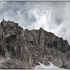 Gargoyle Ridge, Sawtooth Mountains - Idaho<br /> <br /> The youthful spines of the Sawtooth Mountains cut the storm clouds with razor-like teeth. These 'gargoyles' and 'gendarmes' (the spikes of stone that sit atop the ridge) create a haunting backdrop when a storm rolls in. The sky becomes gray and the wind whips the lakes with lively dances of spray and waves. The temperature plummets and you are peppered with sweeps of tiny white hail - snowflakes that have been swirled around the clouds long enough to thaw and refreeze, thaw and refreeze. The color drains from the peaks and everything becomes ghostly and repellant. Rolling thunder booms and echoes along tight-walled valleys, amplifying the power - and the worry. <br /> However, at this very moment, to stand under the meager protection of a great old whitebark pine and watch the show unfold, is without a doubt, to witness the greatest show on earth.