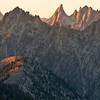 Warbonnet Peak, Sawtooth Mountains - Idaho<br /> <br /> Warbonnet Peak, one of the highly desired climbing gems of the Sawtooths, lies off trail - and is only reached with a considerable amount of toil and sweat. Although its tooth-like summit makes it appear a hostile ascent, there is one route (from the saddle to the right) that is moderate - and memorable.