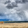 Edge of Spring, New Meadows - Idaho<br /> <br /> Heavy spring clouds give out under the weight of snow and rain. The flat stubbled valley of New Meadows waits for a few more weeks to start its growing season.