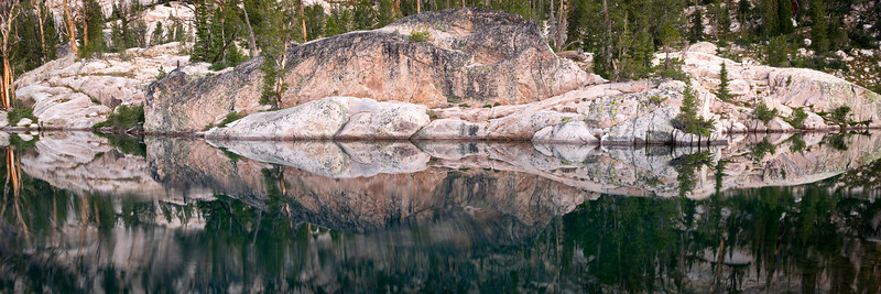Stone Mirror, Sawtooth Mountains - Idaho<br /> <br /> An incredibly still morning at Kathryn Lake, deep within the remote alpine arena of the Sawtooth wilderness. The granite benches, polished into smooth flowing shapes and curves, arch into and out of the indigo water  like abstract architecture.<br /> <br /> Kathryn Lake, where this image was captured, is a special place to me - one that I have been to a handful of times - and one that I will always return to.