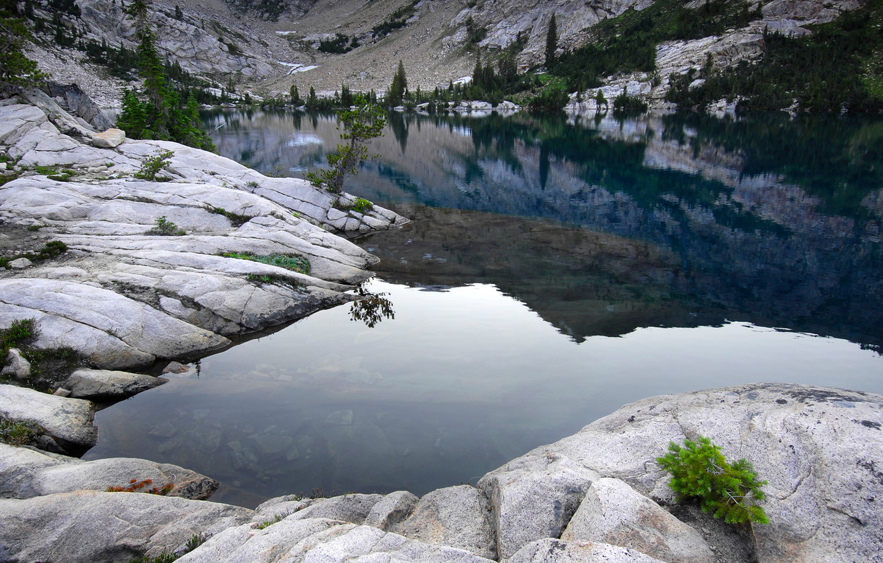 Granite Beach, Sawtooth Mountains - Idaho<br /> <br /> Glacial polished granite benches quietly slip into the clear waters of Lucille Lake, disappearing into the deep water and becoming a bottomless cerulean blue.