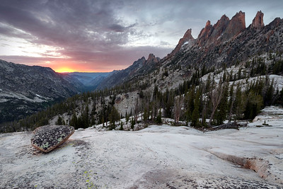 The Lonely Stone, Sawtooth Mountains - Idaho  Sunset over the formidable Goat Creek drainage, with a line of granite spires separating it from the much more pleasant, Baron Creek drainage. The glacier polished rock floors of this valley support a small village of these lonely stones, long forgotten remnants of the great glaciers or  left here after an escape from the peaks above. Either way, they always look to me like they always want to be back with their friends, nestled together in a great field of boulders.
