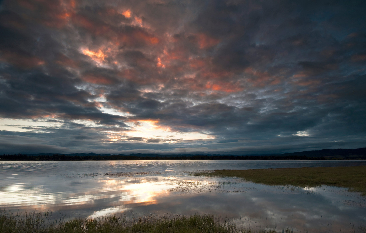 Cascade Lake - Idaho<br /> <br /> Sunrise in spring over Cascade Lake, the sky heralding a day filled with rain and low cloud.