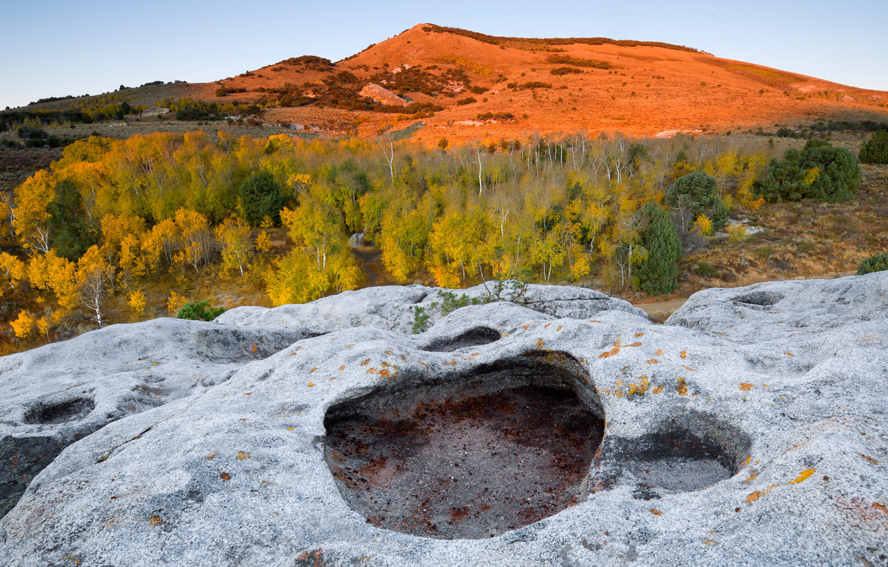 Sunlight and Swiss Cheese, City of Rocks - Idaho<br /> <br /> Autumn near Bath Rock, in the City of Rocks. Panholes like these form in the granite stone over a millennium. Panholes begin as tiny depressions or cracks where water remains for long periods of time. The longer water remains on the granite surface, the greater the dissolution of minerals by acidic water.