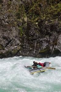 Nolan Verga hits the bottom hole in Greenwall on Oregon's Illinois River, April 2011.