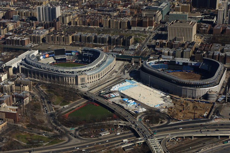The new and old Yankee Stadiums, respectively.