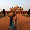 DELHI. HUMAYUN'S TOMB. CARRYING GOODS AT SUNSET.