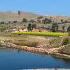 Quiet lake and beautiful countryside with green hills in Rajastan, India, Asia